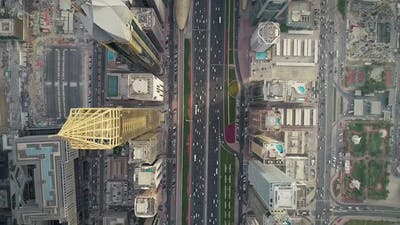 Aerial view of Dubai colourful skyscrapers, and long busy road ,UAE.