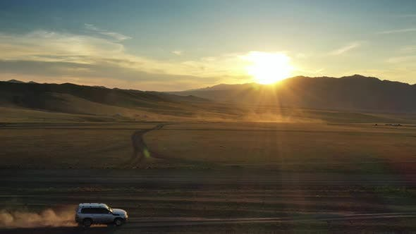 Thumbnail for Aerial View of Cars and Yurts in Mongolia Sunset