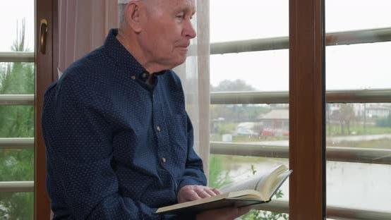 Thumbnail for An Old Muslim Man Reading Koran