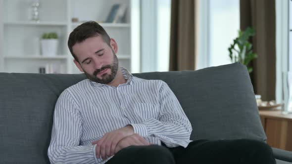 Thumbnail for Young Businessman Having Nightmare on Sofa at Home