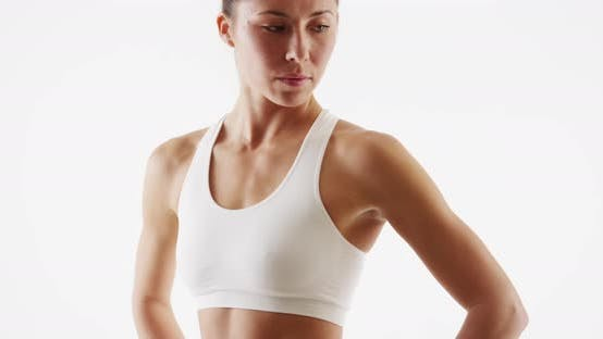 Thumbnail for Lean woman trainer standing white background
