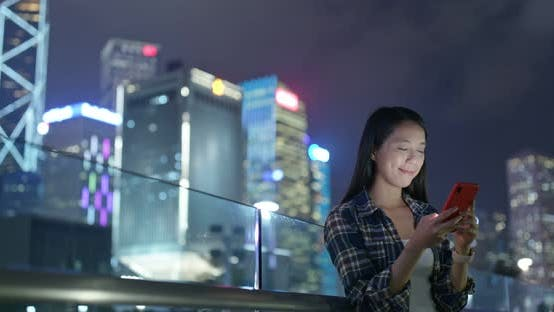Thumbnail for Woman check on mobile phone at outdoor in city at night