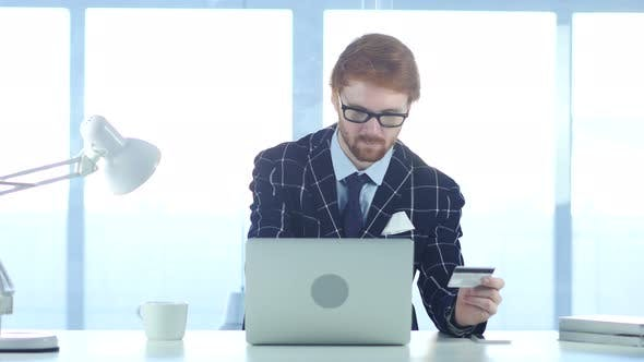 Thumbnail for Redhead Businessman Busy in Online Shopping, Payment by Credit Card