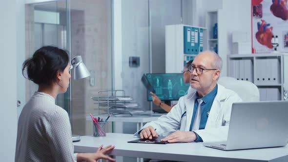 Thumbnail for Senior Doctor Giving Medical Consultation