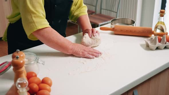 Old Woman Preparing the Pastry Dough