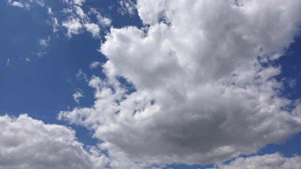 Thumbnail for Clouds in the blue sky, time-lapse. Abstract background. Bright colors in the heaven