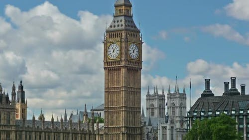 Time lapse of clouds with Big Ben on a sunny day. London, United Kingdom.