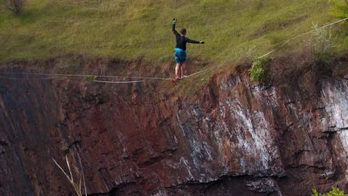 Balancing on a Rope Over a Massive Pit Amazing Courage of a Man