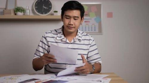 Businessman looks growth of sales secretary sorts documents