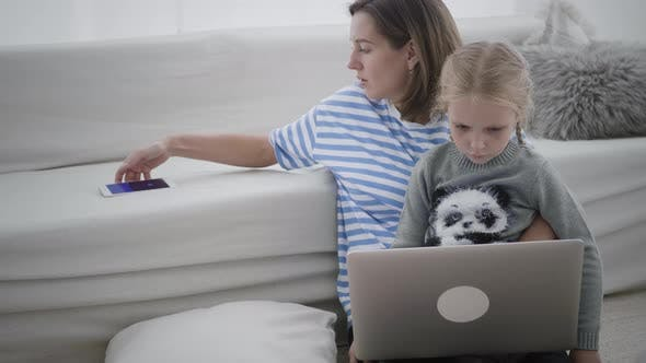 Woman is working from home with child