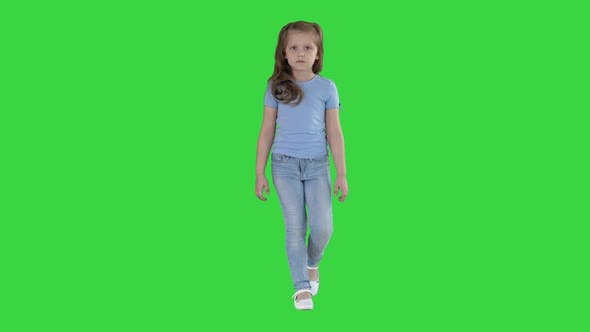 Thumbnail for Little Girl in Jeans and Blue T-shirt Walking on a Green Screen, Chroma Key.