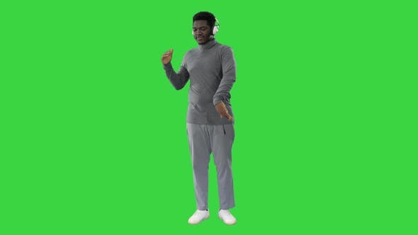 Thumbnail for Passionate African American Man Listening To the Music in Headphones and Dancing on a Green Screen