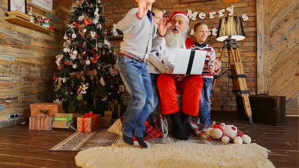 Thumbnail for Santa Claus Plays with Three Kids on Computer.