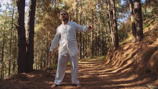 Man Dancing In Trance In Forest