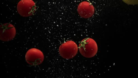 Thumbnail for Fresh Vegetables Cherry Tomatoes and Bell Pepper Falling Into Water Black Background