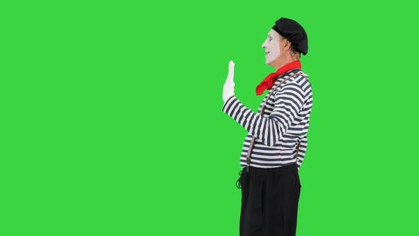 Mime Playing a Pantomime Performance Walking and Opening Imaginary Door on a Green Screen Chroma Key