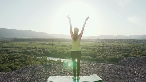 Cover Image for Young Woman Doing Training Yoga on Top of a Mountain