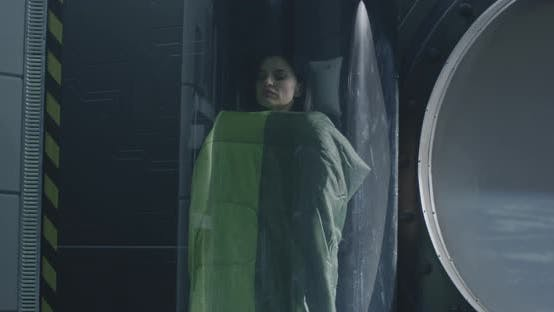Thumbnail for Female Astronaut Sleeping in a Glass Pod