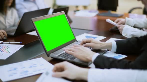 Cover Image for Businessman Working on Laptop With Green Screen at Business Meeting, Conference