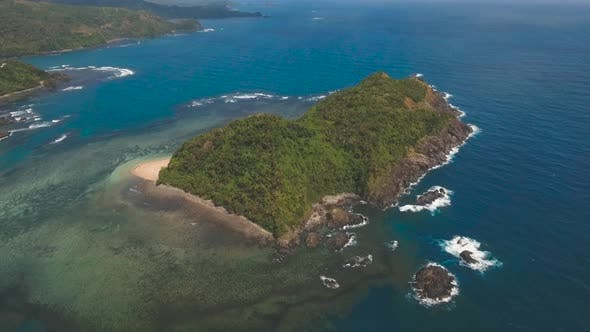 Cover Image for Seascape with Tropical Island, Rocks and Waves. Catanduanes, Philippines.