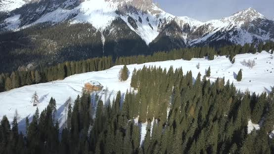 Thumbnail for Aerial drone uav landscape nature views of a cabin house in snow mountains in the winter.