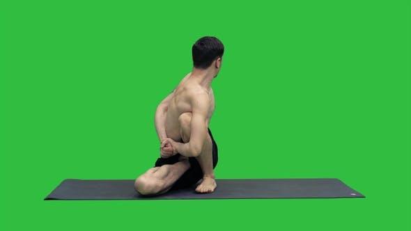 Thumbnail for Man practice yoga Sage Twist C pose or Marichyasana pose