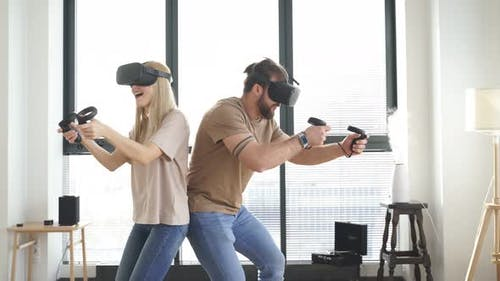 Couple in VR Helmet with Controllers