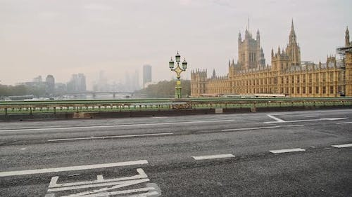 Quiet, empty and deserted roads and streets in London in Coronavirus Covid-19 lockdown at Westminste