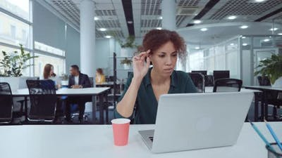 African American Businesswoman Working on Laptop in Coworking Space
