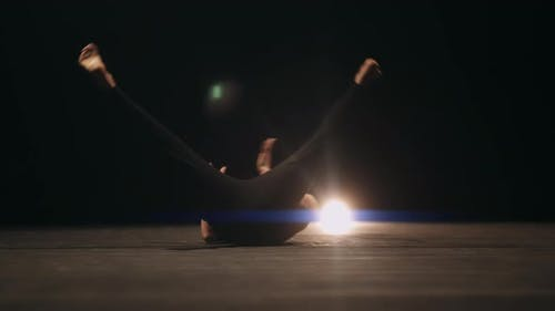 A Choreographer is Break Dancing on Stage