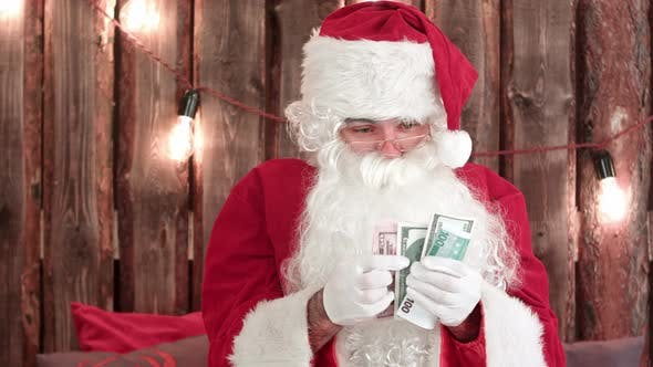 Thumbnail for Santa Claus Counting His Money and Showing Money Disappearing Trick