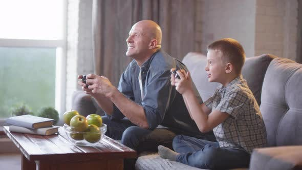 Thumbnail for Happy Father and Son Winning while Playing Video Game
