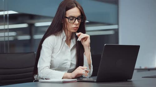 Businesswoman Financial Analyst Using Laptop in Office