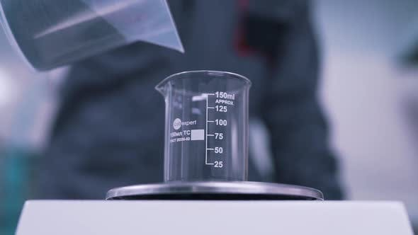 Thumbnail for the Scientist Weighs the Material in the Lab
