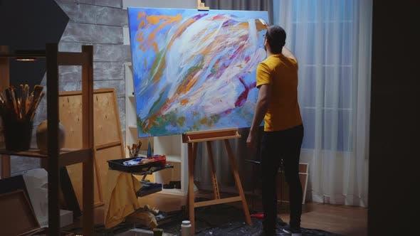 Guy Artist in Art Studio