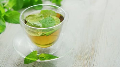 Cup of Green Tea with Mint and Lemon