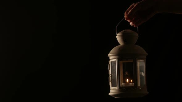 Thumbnail for Hand Holding Lantern With Candle Light