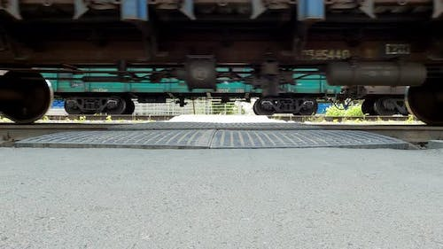 Wheels Freight and Passenger Trains Driving on Railway Rails View From Asphalt