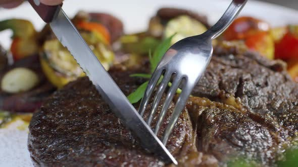 Cutting Beefsteak with Fork and Knife