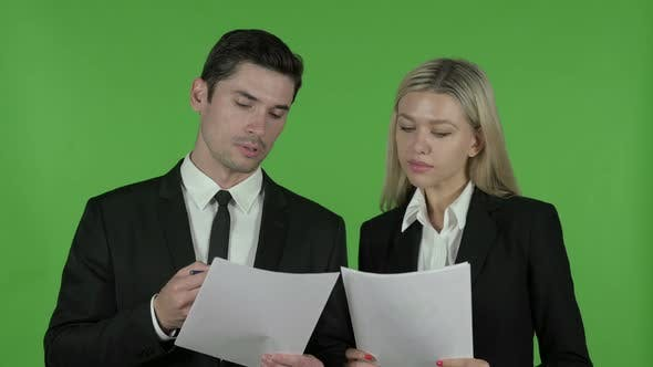 Thumbnail for Young Business People Reading Documents, Chroma Key