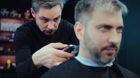 Brutal Hairdresser Stylist Professionally Works As a Hair Clipper