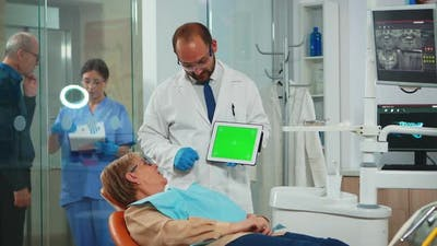 Dentist Pointing at Green Screen Display