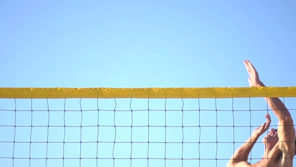 Thumbnail for A man spiking a beach volleyball
