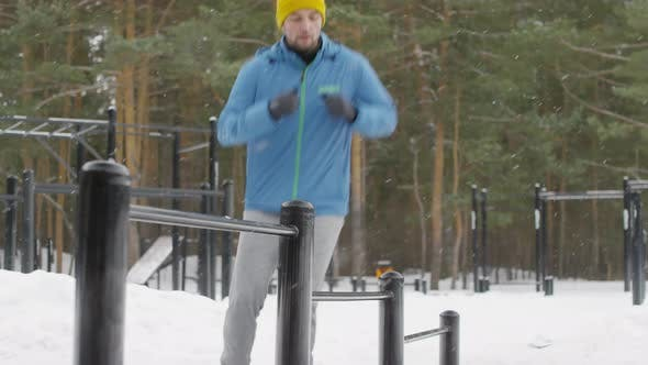 Thumbnail for Fit Man in Blue Windbreaker Doing Endurance Exercise Outdoor in Winter