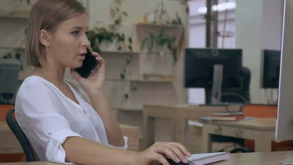 Thumbnail for Businesswoman Has Phone Conversation in Office