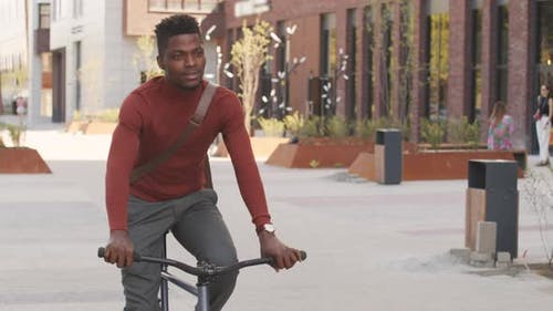 African American Man Riding Bike Outdoors