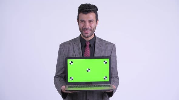 Thumbnail for Happy Bearded Persian Businessman Showing Laptop