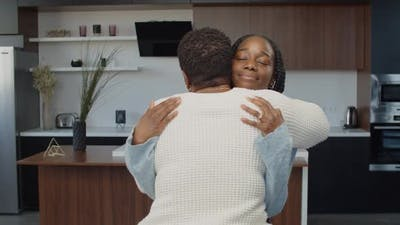 Affectionate Black Teenage Girl Hugging Mom Indoors