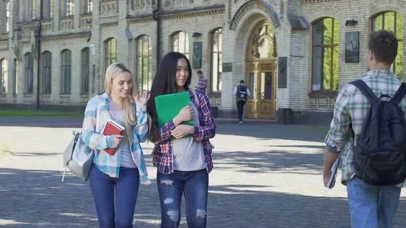 Thumbnail for Female Students Walking Near University and Smiling to Men. Flirt. Slow-Motion