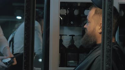 Trimming beard in barbershop